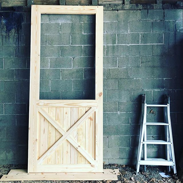 "Extra big, extra thick stall doors. The center rail and ladder are around 4' h, the top of the door is 9' 3"". #barndoor #stalldoor #handcrafted #madeinamerica #madeinnewengland #barndepot"