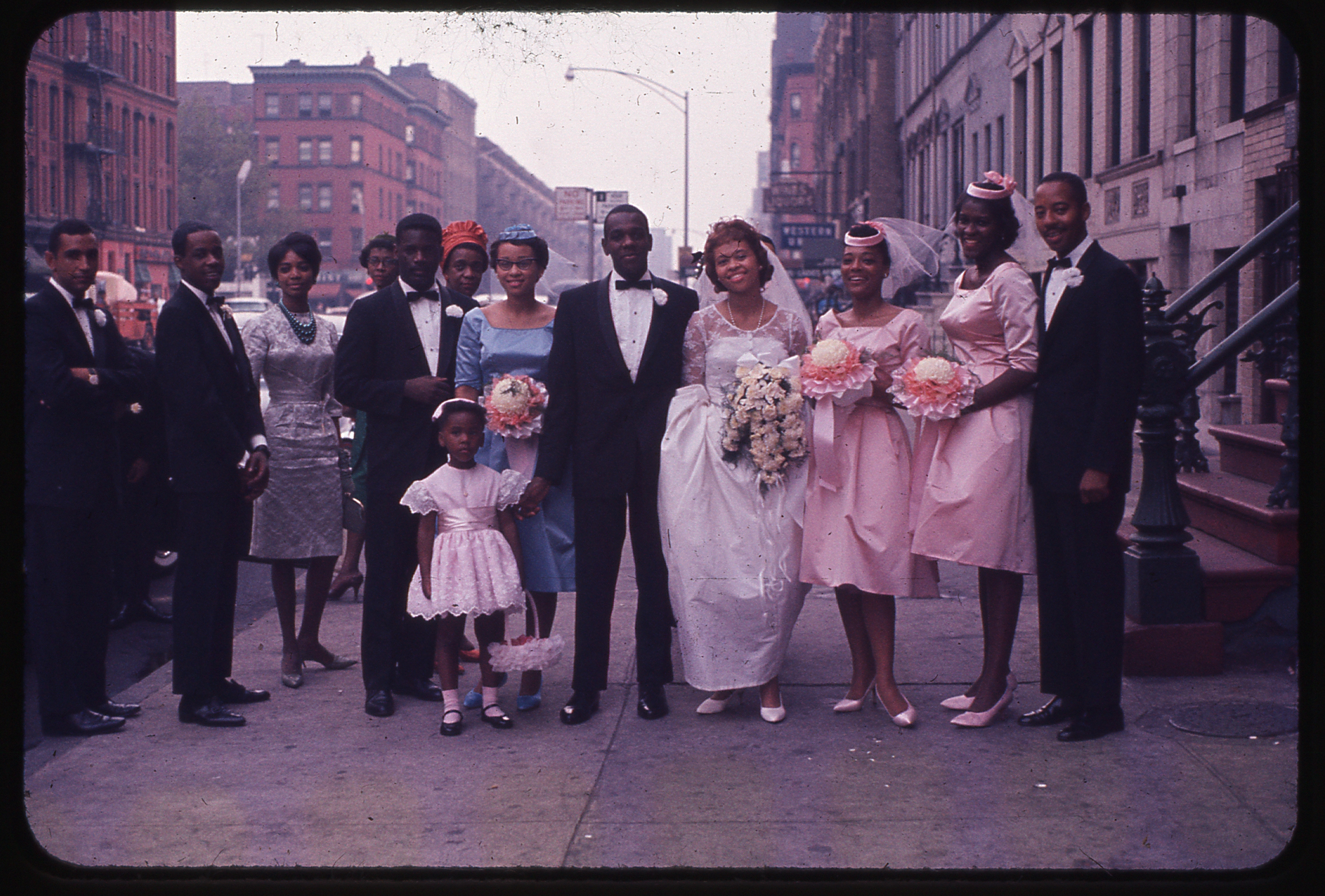 Thomas Allen Harris' parents wedding party on Lenox Avenue, Harlem, USA. Photograph taken by his grandfather Albert Sidney Johnson, c. September 1961