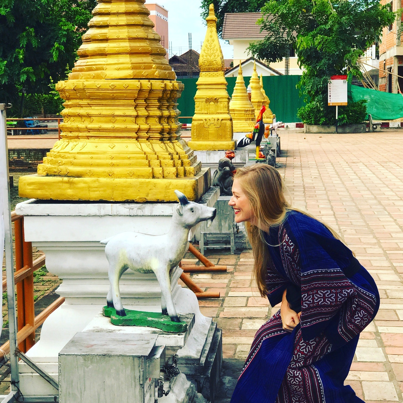 "Wat Chedi Luang, near the place where I always stay in Chiang Mai. I like to visit every morning when I'm there. The ""Hmong kimono"" is a gift from an artisan friend. The myriad temples covered in gold leaf are the inspiration behind the Gold Bird high and low tops."