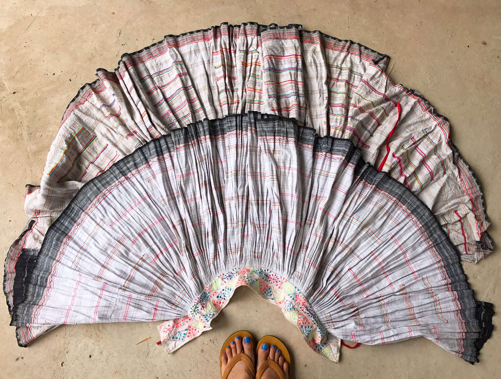 Vintage Hmong skirts made from handwoven hemp, also featuring hand embroidery, pin stripe applique and batik dyeing. I love the pastel pinks, yellow and blues on these skirts, the colors which made their way into the Thai Flower slip ons in pink.
