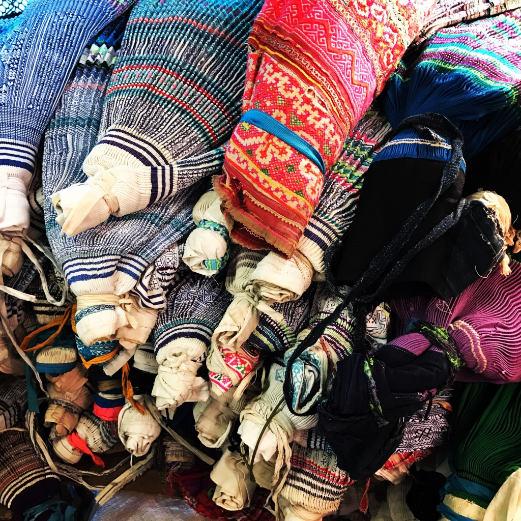Vintage Hmong skirts in market.jpg
