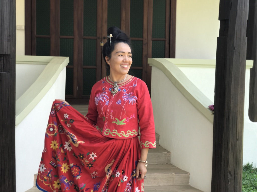 Sarisa, an incredible Thai designer and a personal fashion icon of mine. Sarisa is training a younger generation of Thai and hill tribe women in fashion design and traditional embroidery. She is the scarlet Thai Flower.