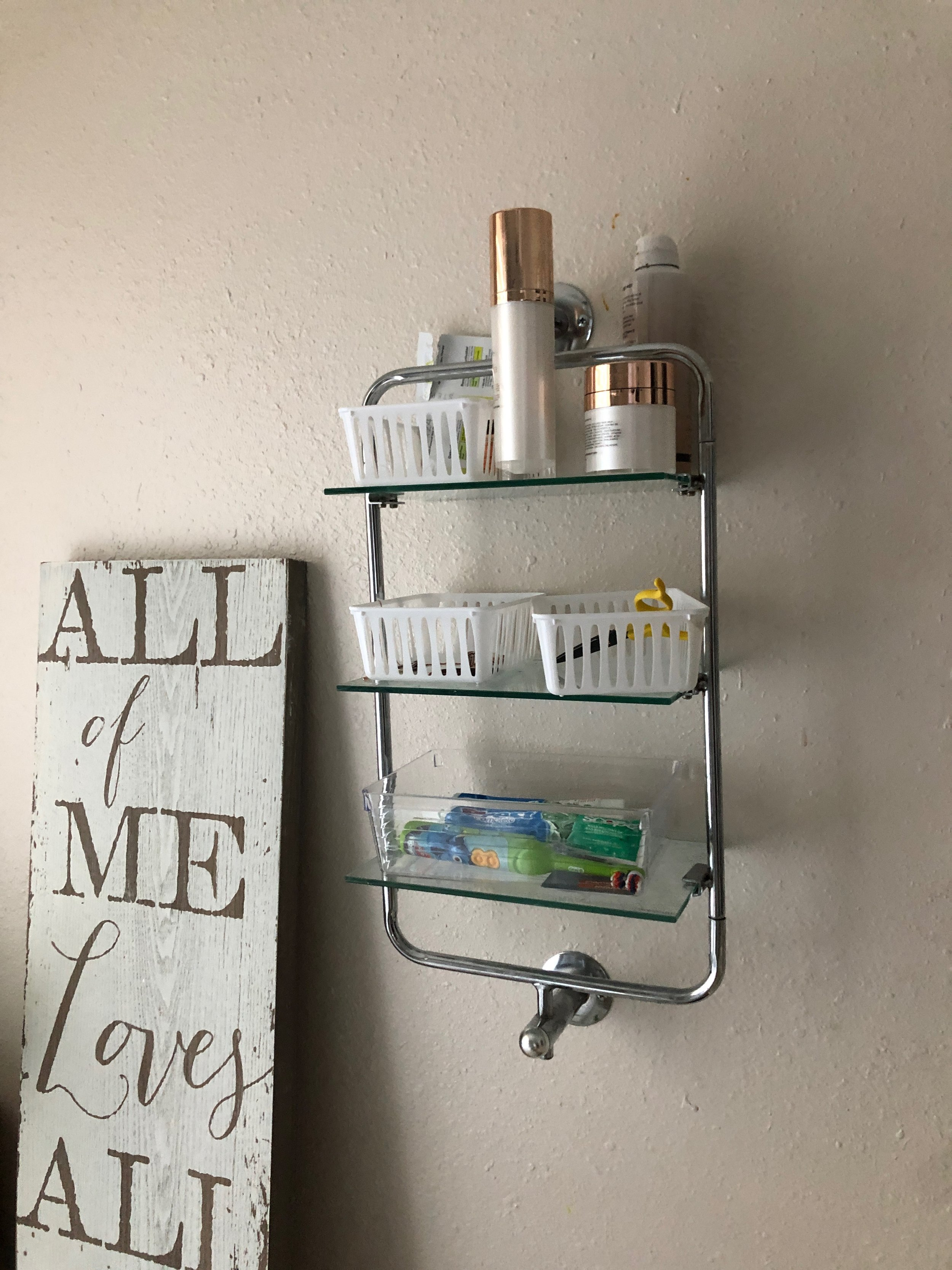 I had a small budget to work with and couldn't hire any subs. Mostly cuz I wanted it to be my project, but also because of the time, money and inconvenience. SO I DID IT.   It started with taking down the light and tearing off the mirror. The mirror went on with A LOT of glue, and I didn't have a pry bar. I used a butter knife and some plastic ikea spoons. The first break smacked my in the forehead and cut the skin. After that I watched youtube videos and taped up the mirror to keep it in tact.