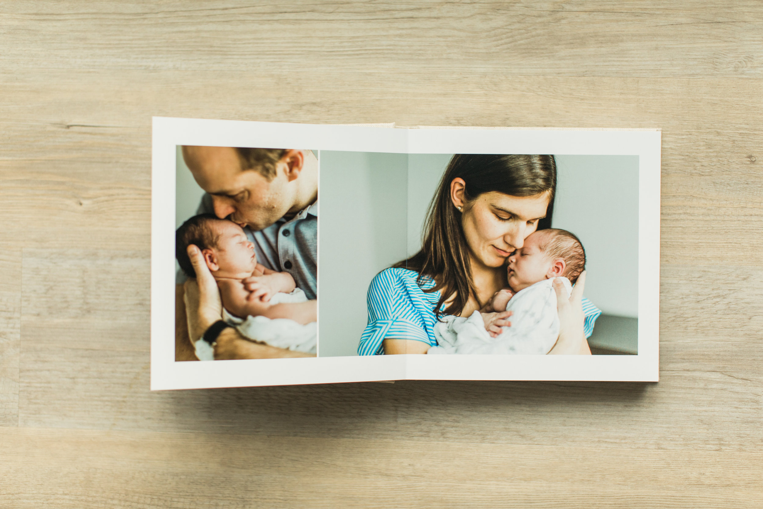 The inside pages of a baby photo album are shown.