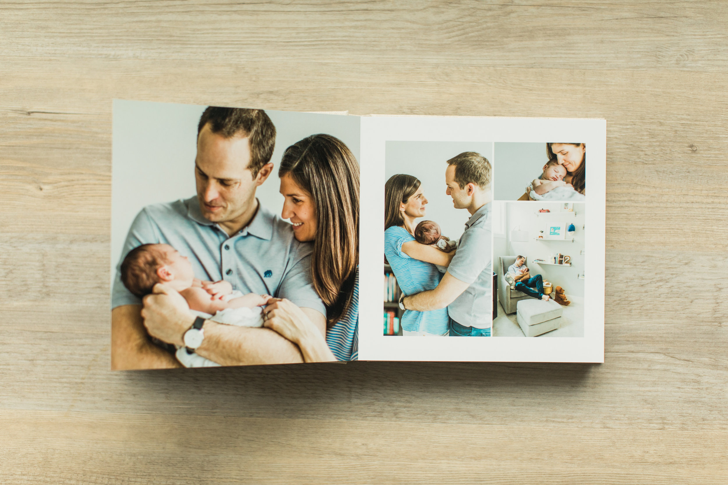 A baby photo album sits on a table, opened.