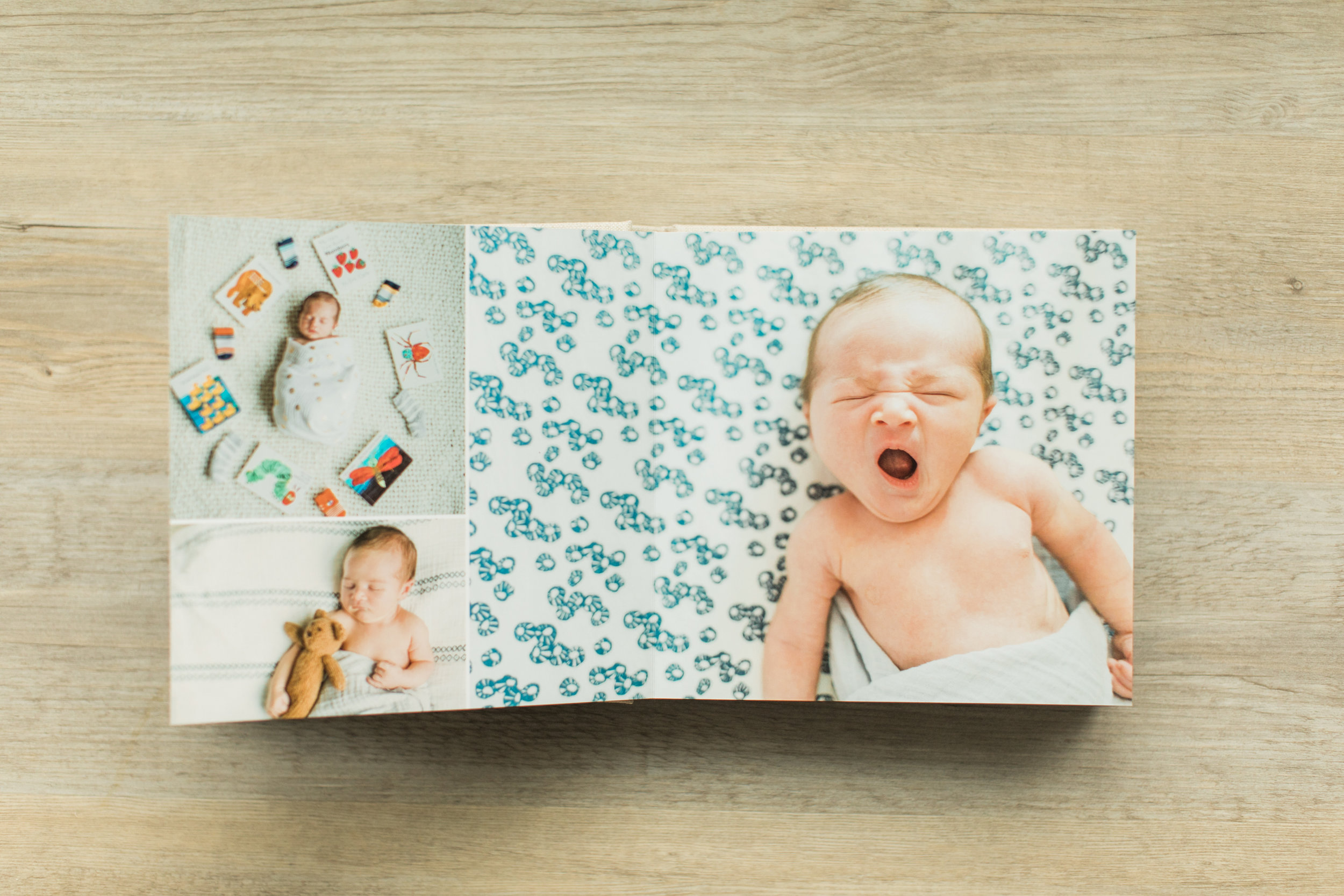 A photo of a baby yawning is inside of a baby photo album.
