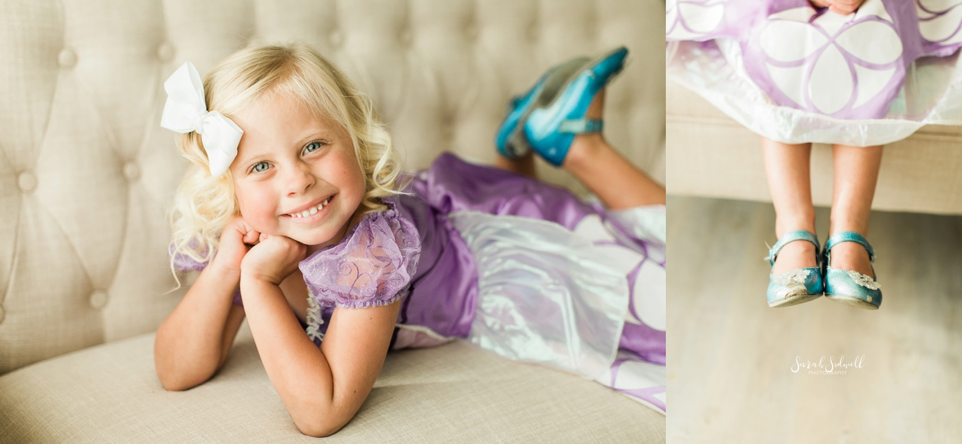 A girl lays on a couch during some family photography sessions.