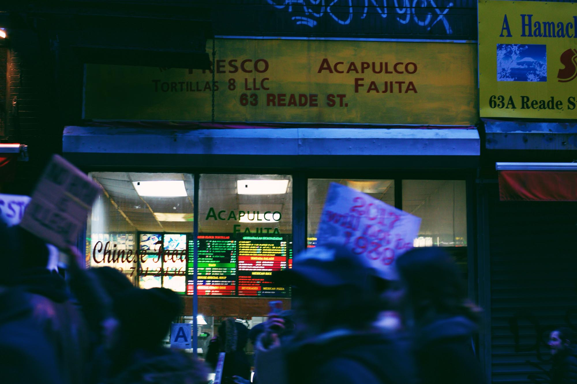 On my way home from the march, I took a detour through Chinatown. I came across a takeout place that served both Mexican and Chinese food, and thought, how American…