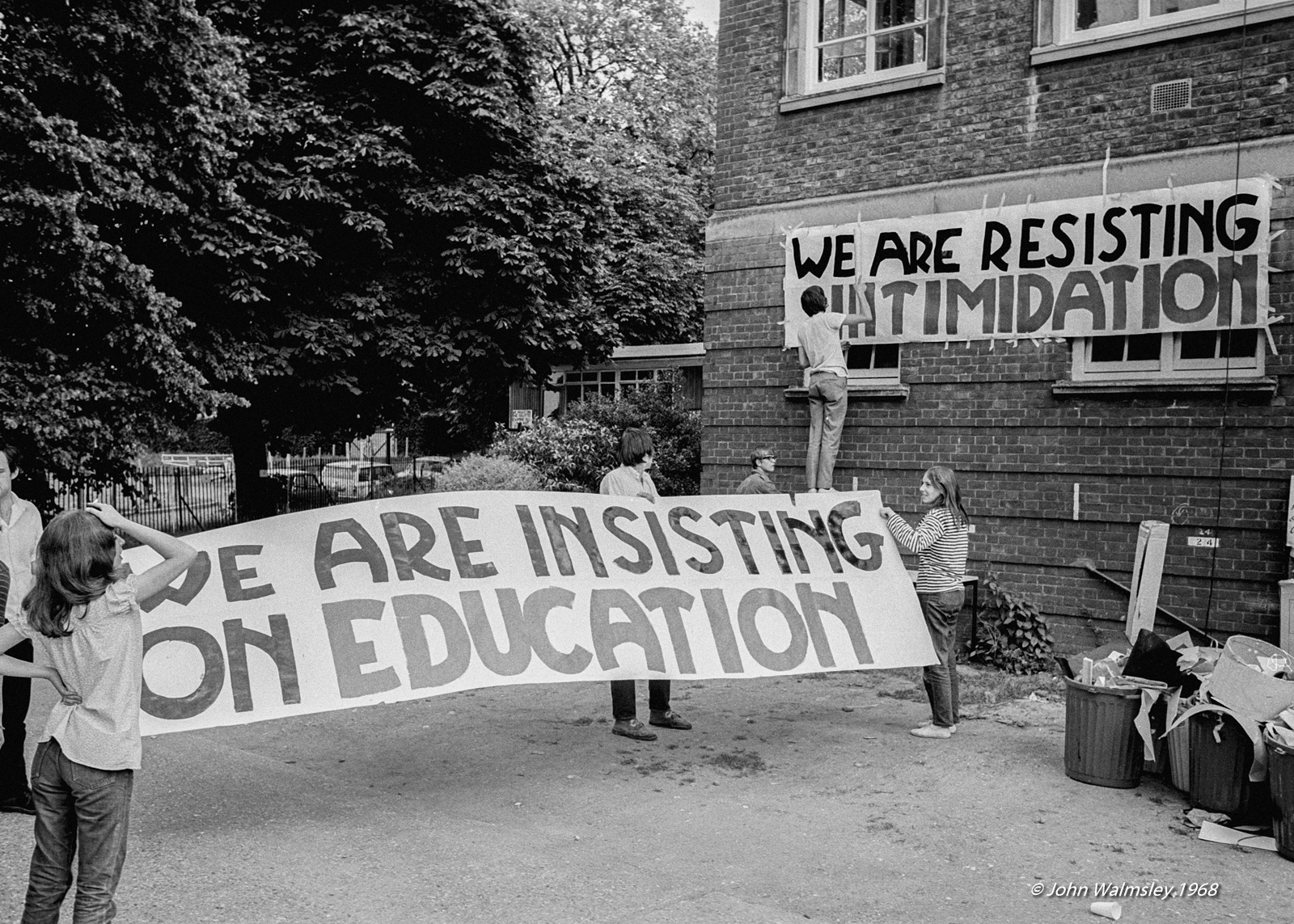 Students hang banners during the sit-in