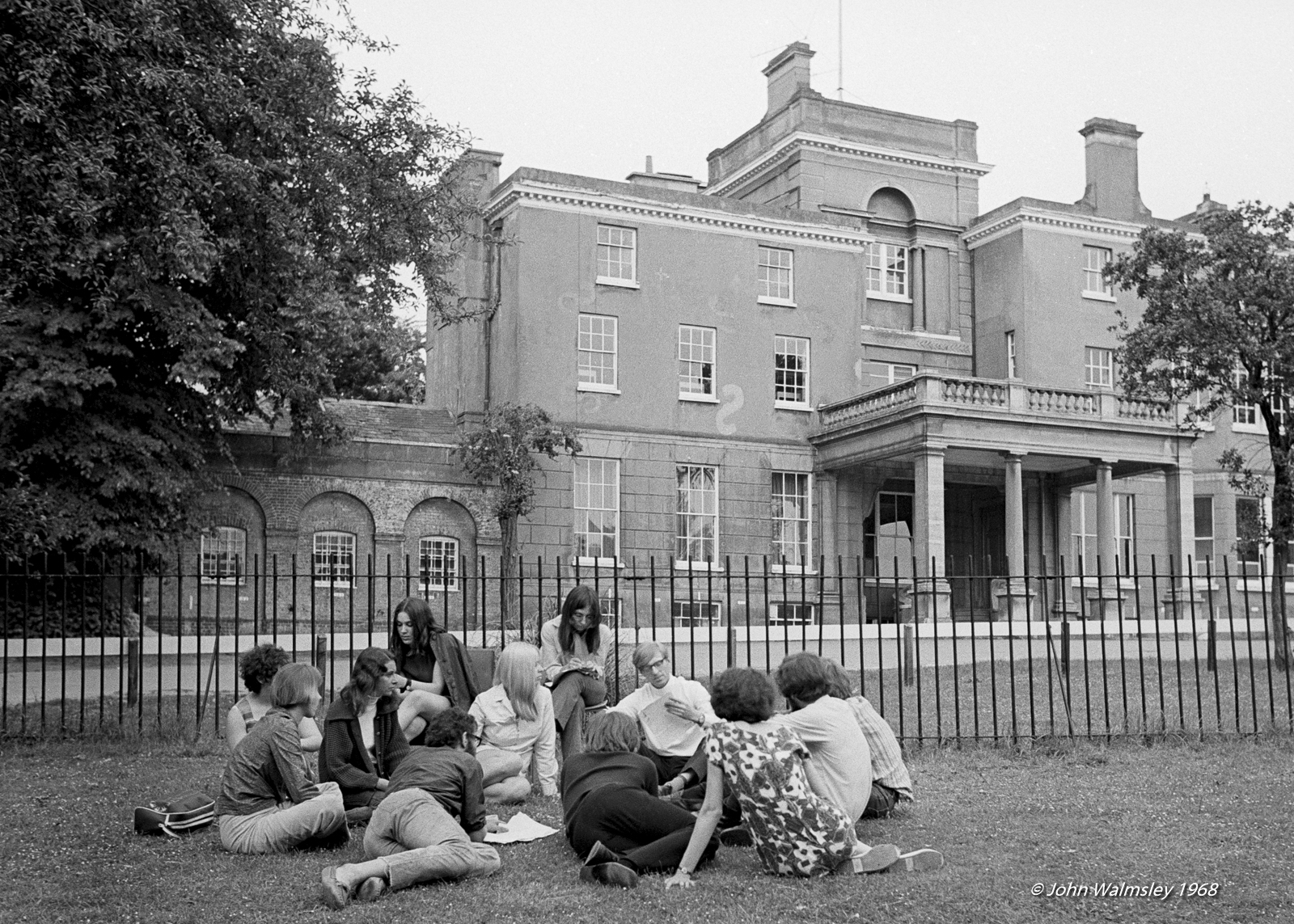 Students talking things through on the grounds of Guildford School of Art with Sociology tutor Mike Steadman during the sit-in