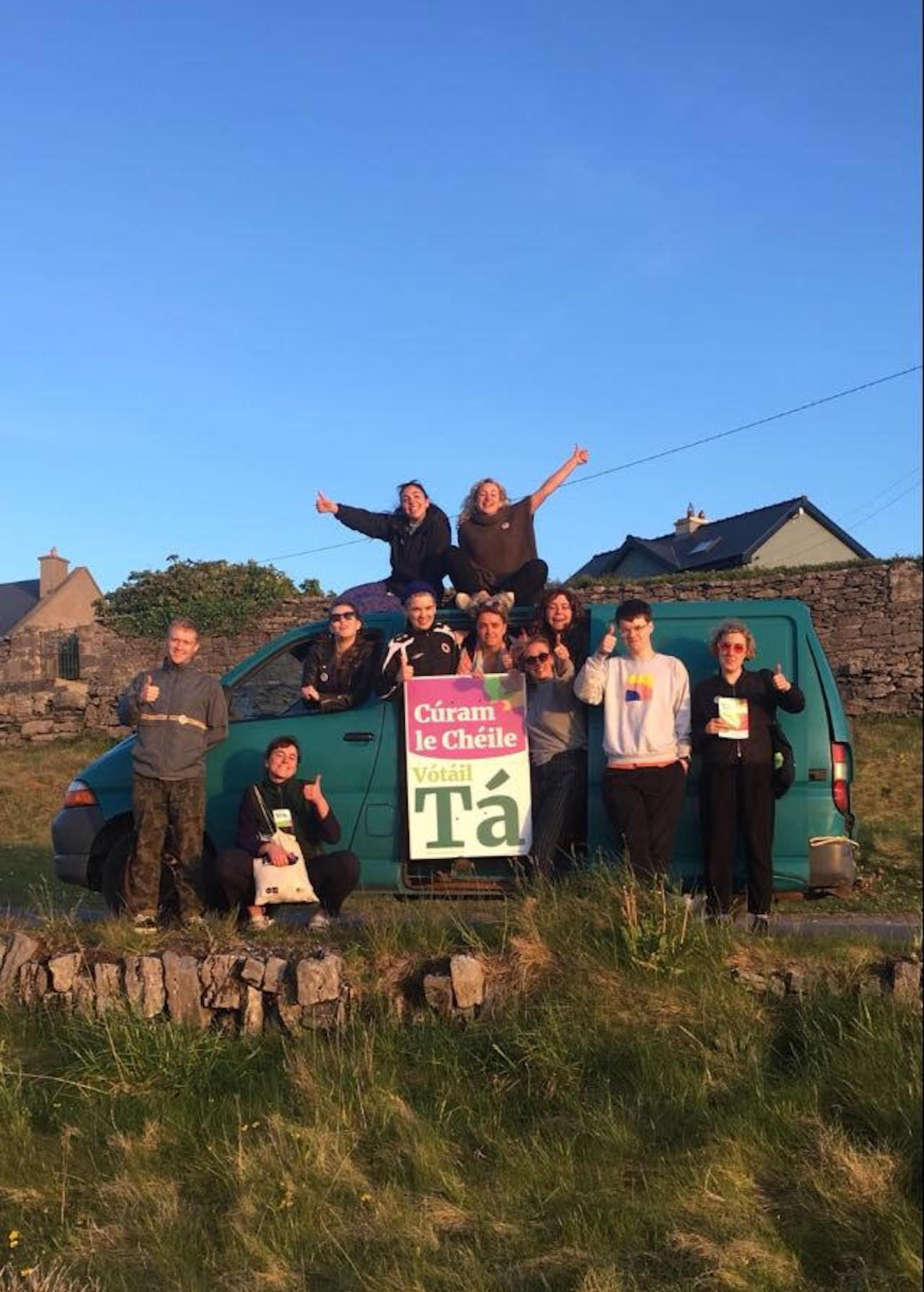 """""""Caring together by voting Yes"""" reads a sign held up by participants at this year's Drop Everything on Inis Oírr. Photo: Mary Nally."""