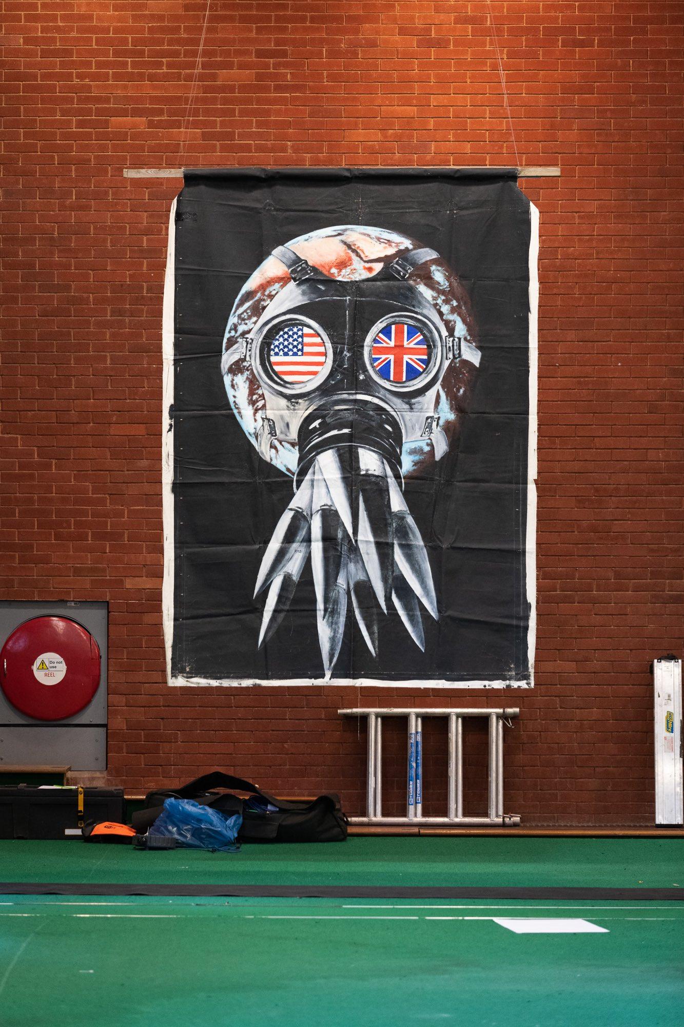 Peter Kennard banner, by Ross Fassbender