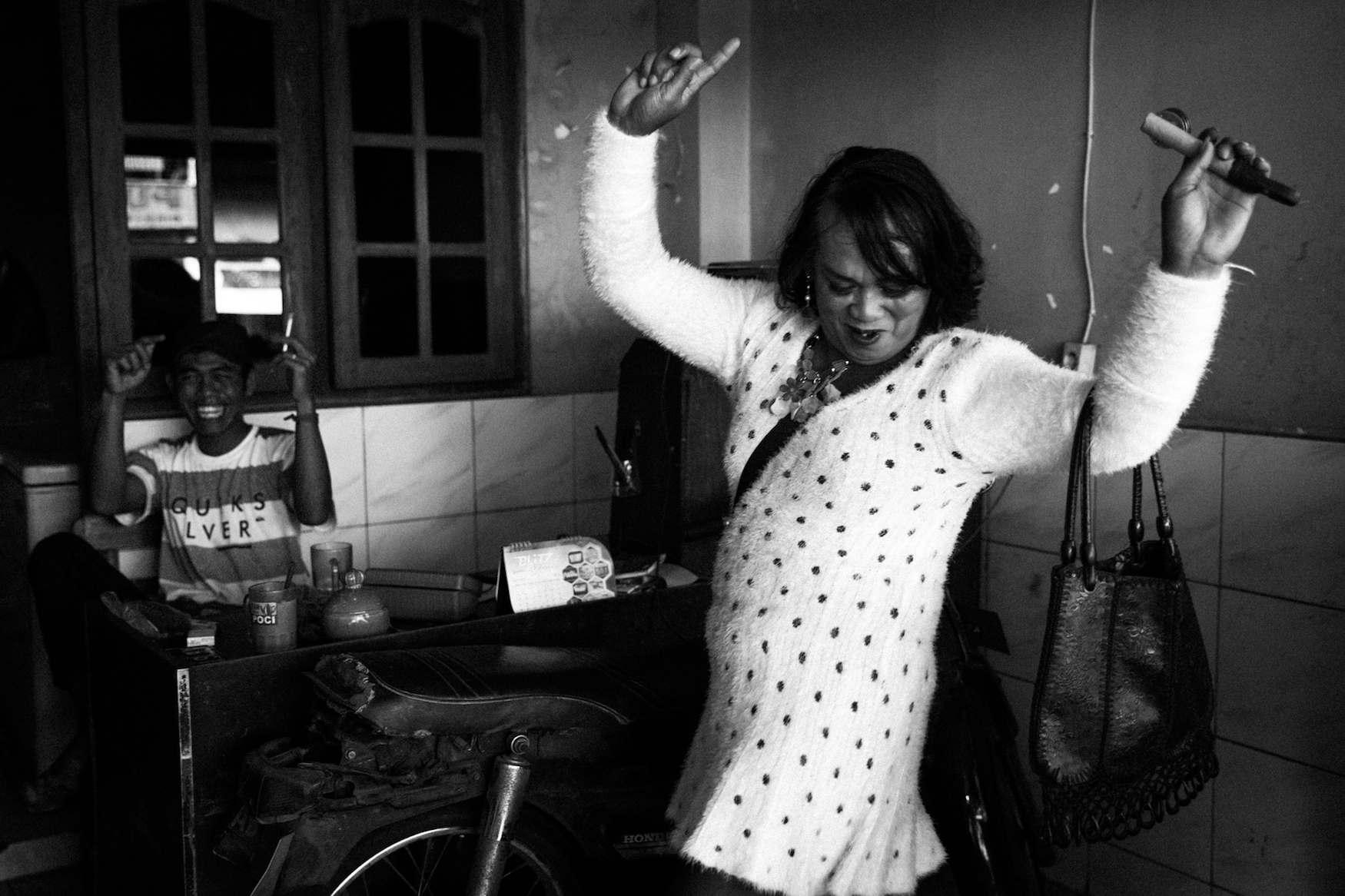 Nur Ayu no longer works as a prostitute, but still sings and dances in the street for a few rupees.
