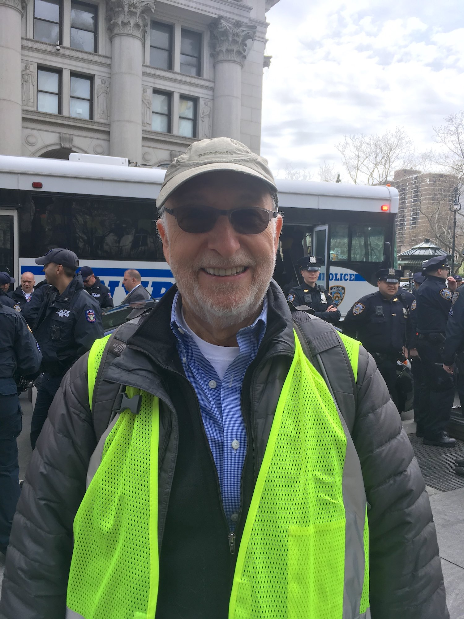 Bob Kolodny, a Marshall with Extinction Rebellion, in front of the arrestees bus, City Hall