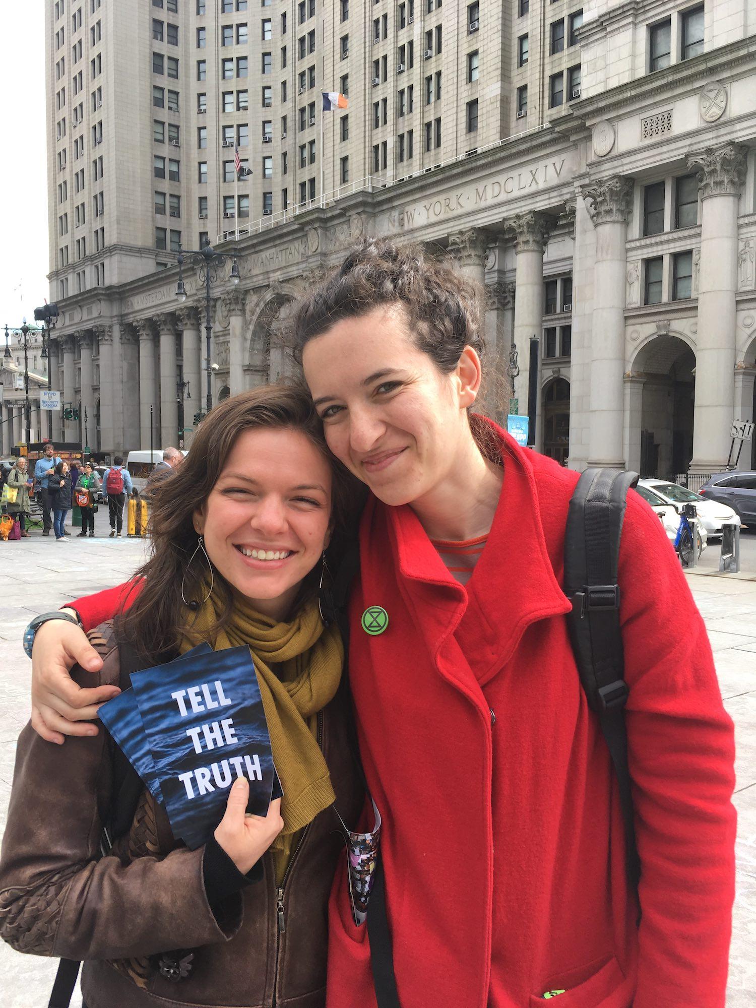 Liz Moyer and Zettie Shapey (l–r), in front of the David N. Dinkins Manhattan Municipal Building facing City Hall