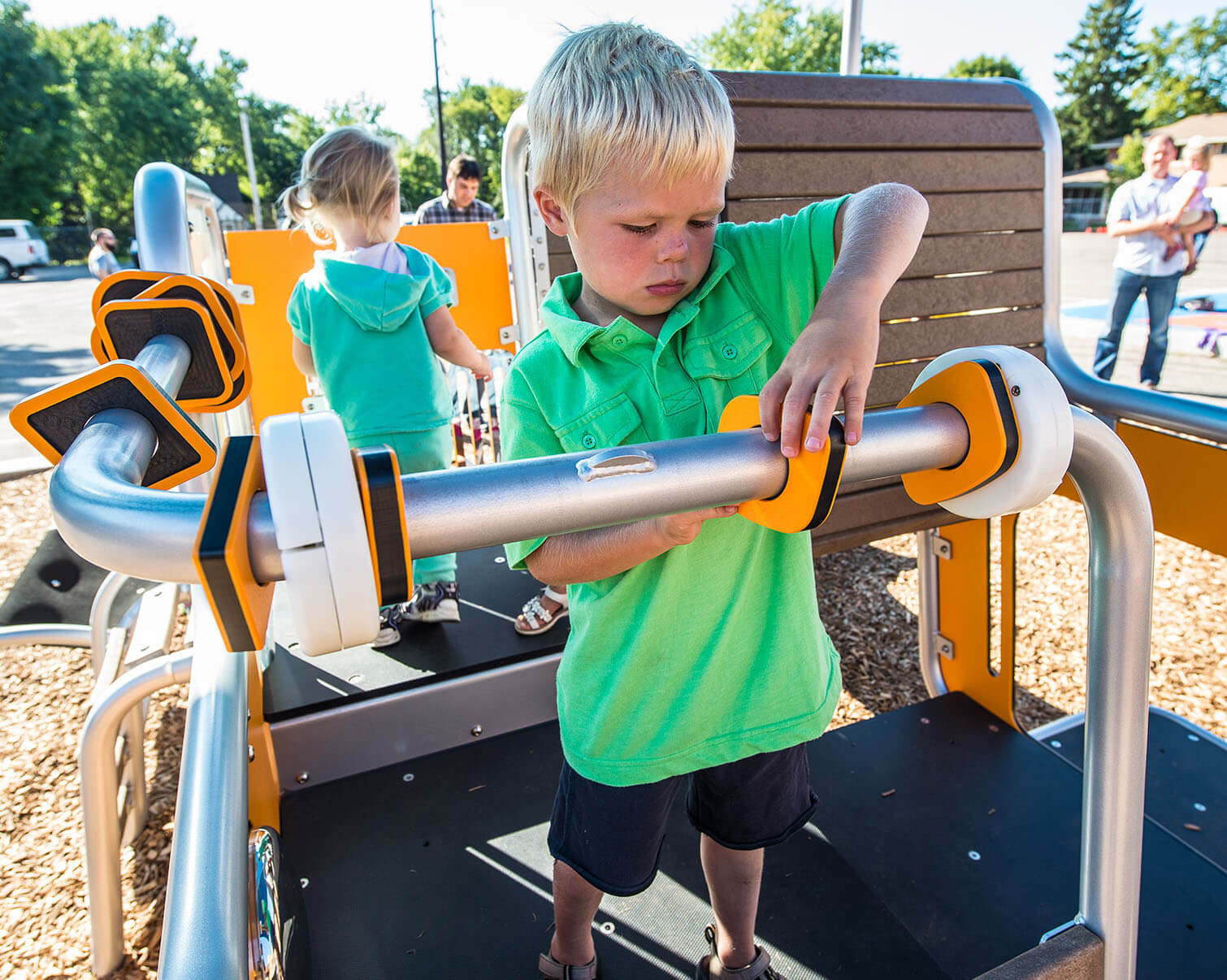 A small child plays on a playground planned for Canals Townhomes in Airdrie.