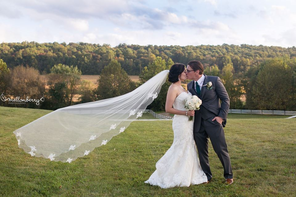 ashleigh and keving veil blowing.jpg