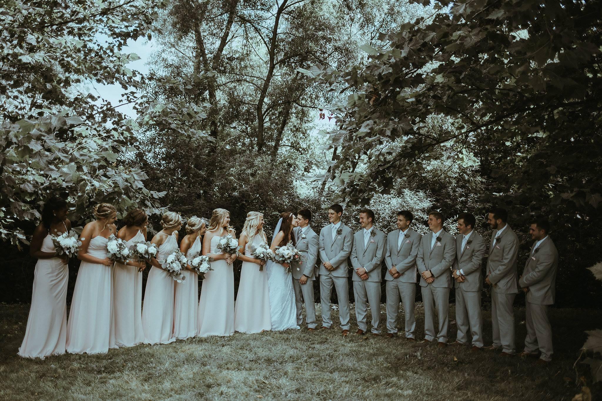 kylie kissing bridal party.jpg