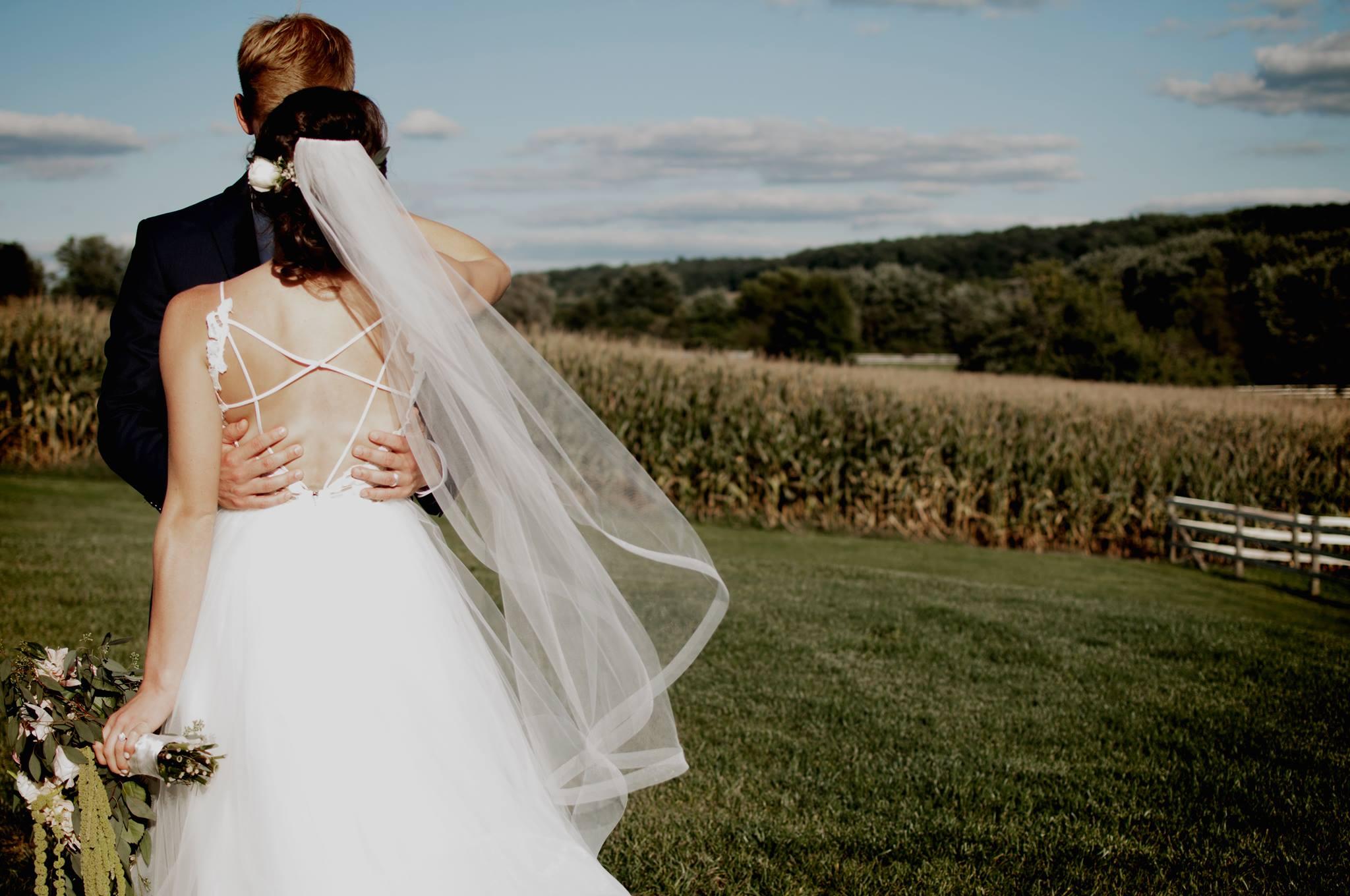 eric and missy kissing cornfield.jpg