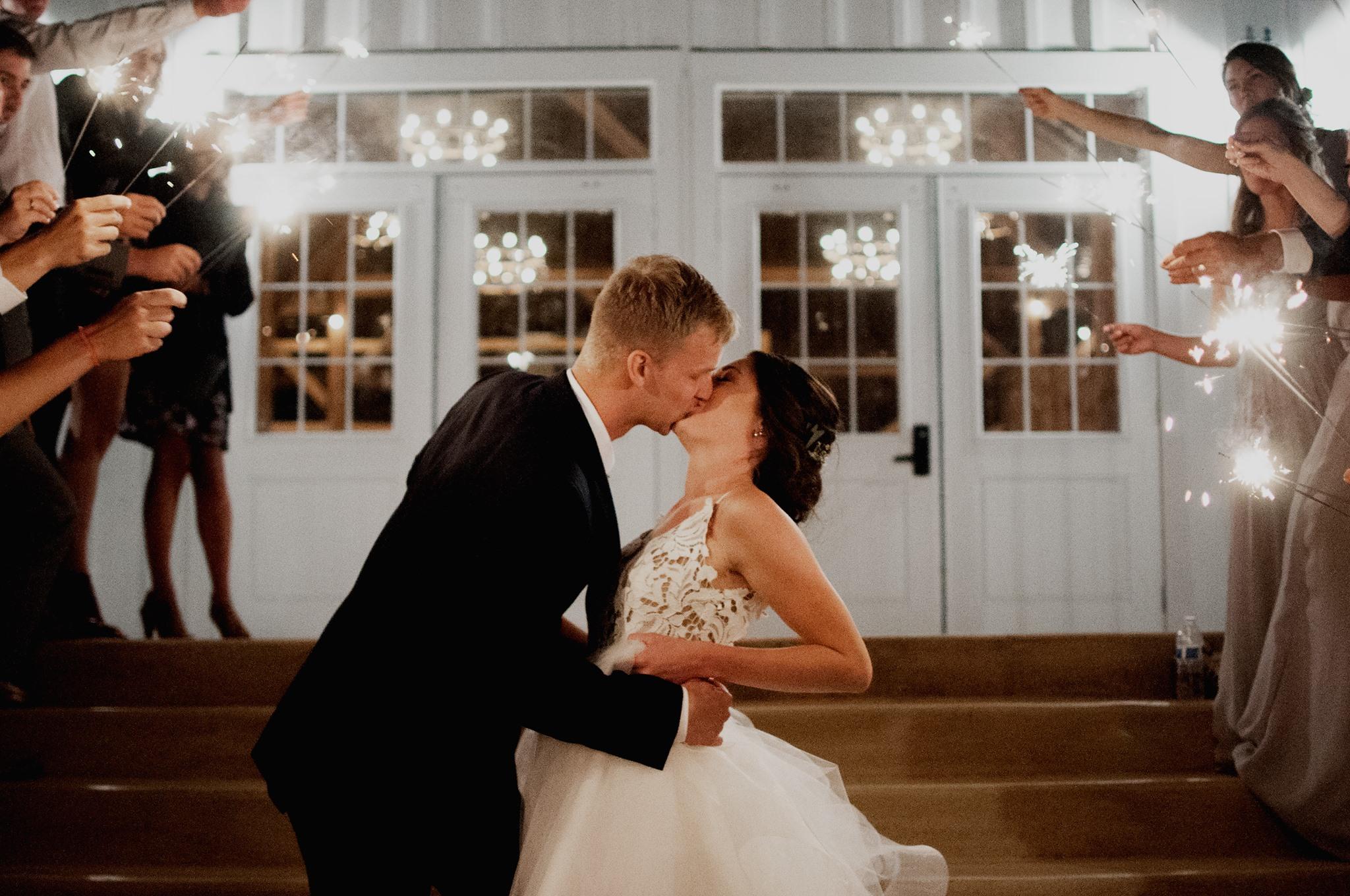 eric and missy sparkler kiss.jpg
