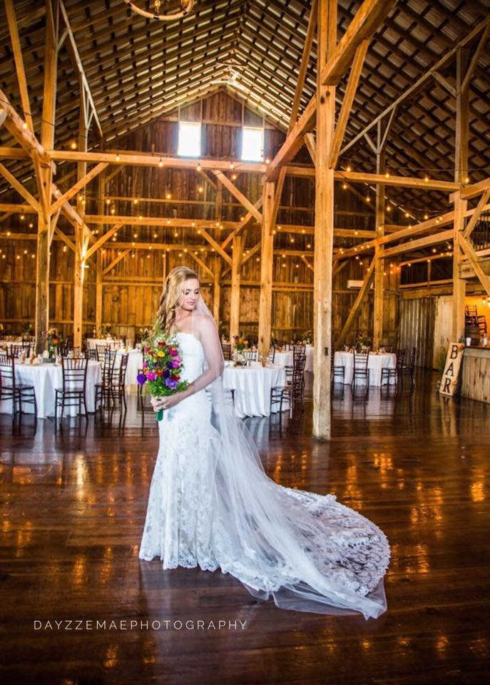 leanne in barn with lights.jpg