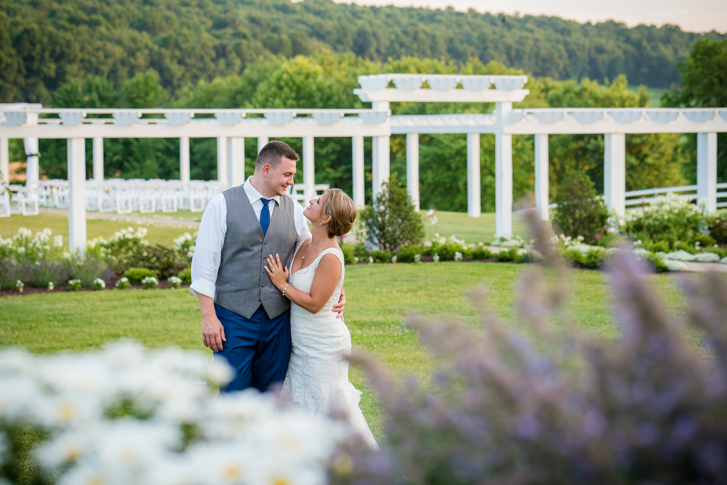 bride and groom with pergola in back.jpg