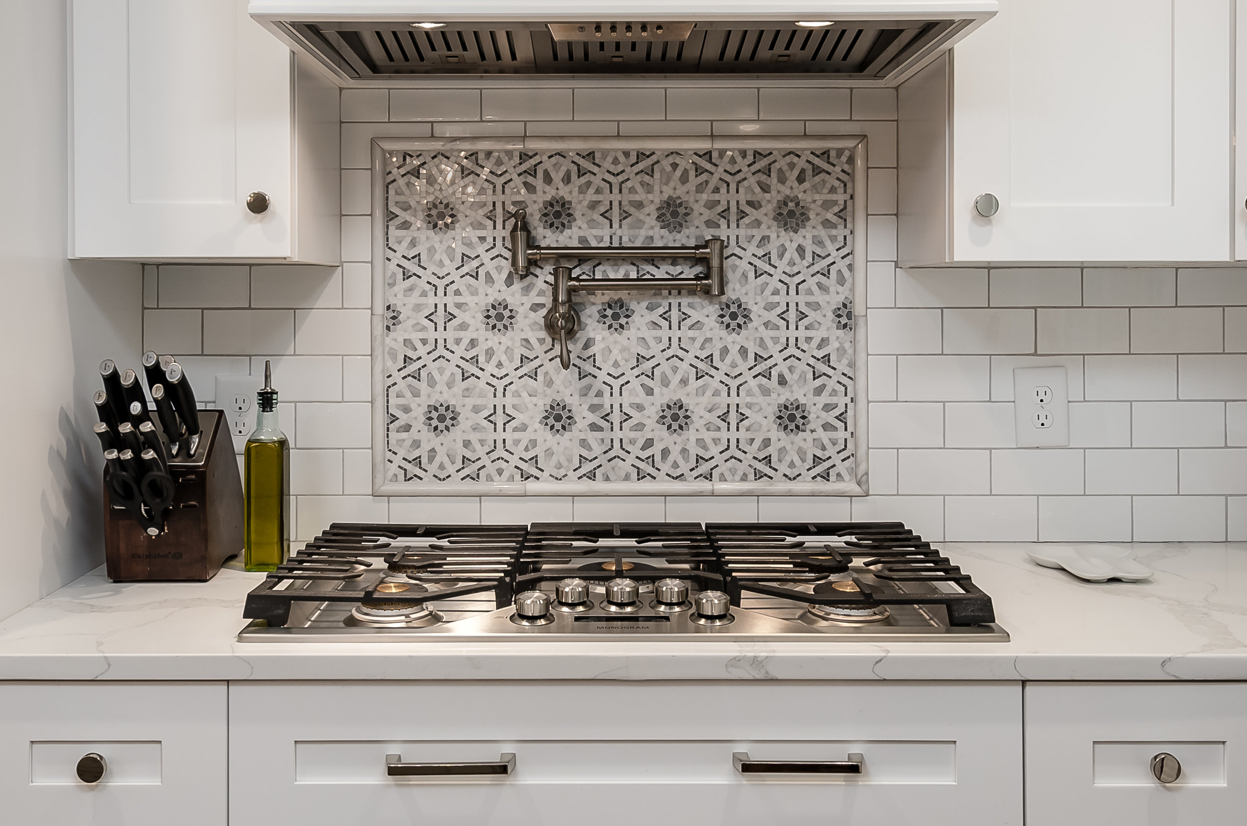 Featuring Monogram appliances and Walker Zanger mosaic tile from Clayton Tile Design.
