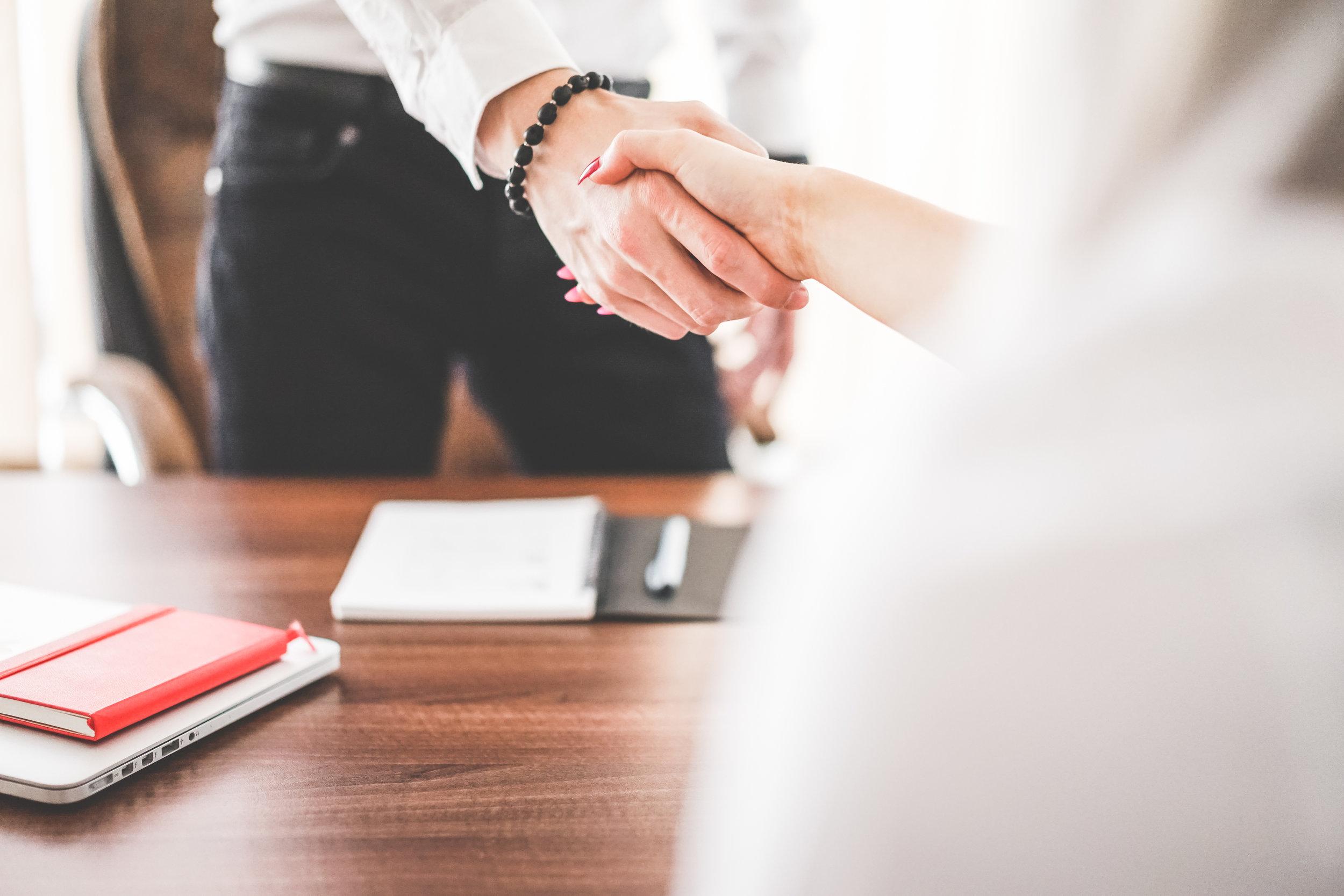 business-man-and-woman-handshake-in-work-office-picjumbo-com.jpg