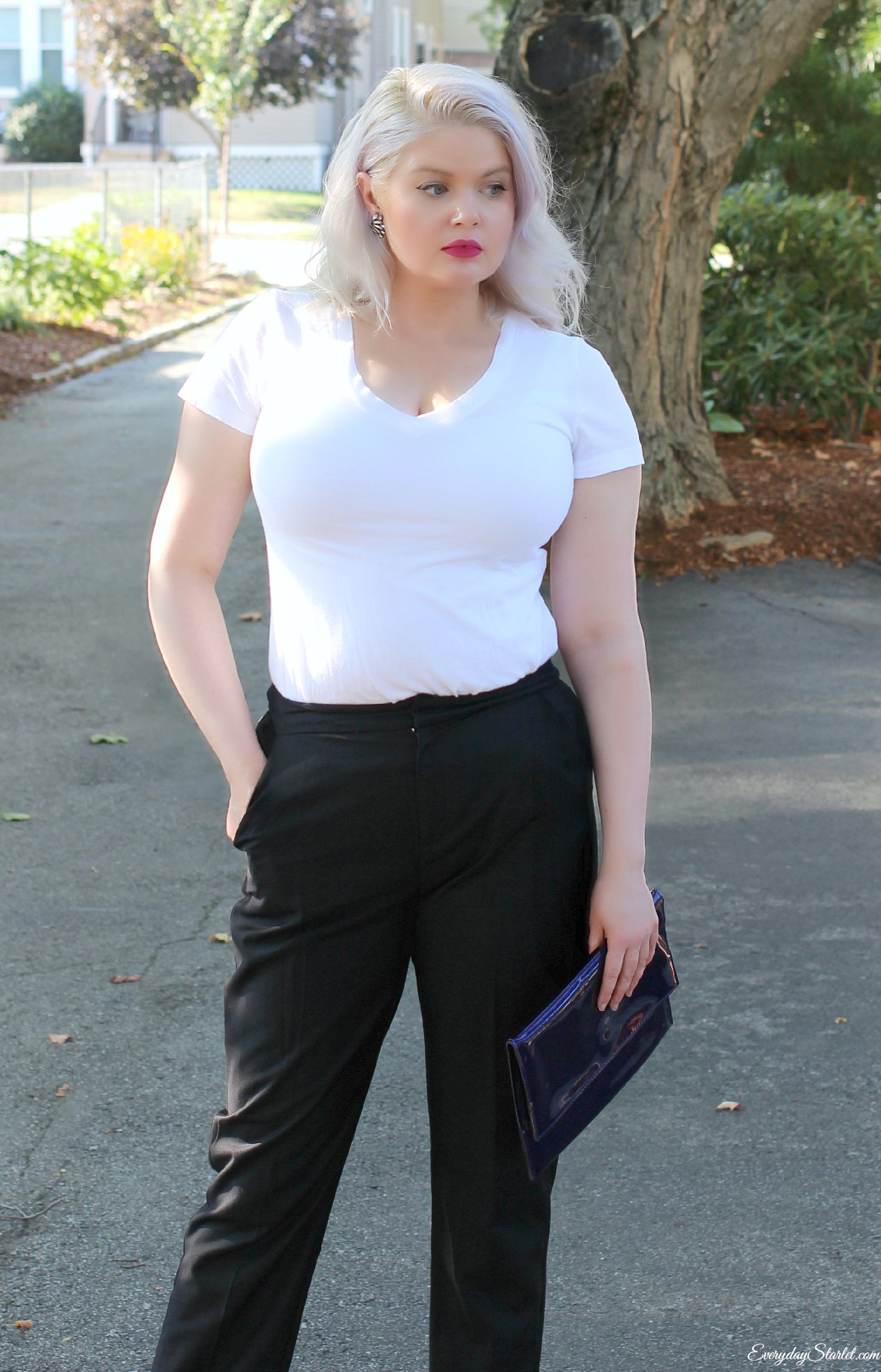 WERK!!!!  Who says curves aren't sexy?  There is so much yes in this photo.  Girls with a more ample bust should not shy away from white or from a more fitted shirt.  I like the confidence this woman exudes and I like the different take on a classic menswear look.