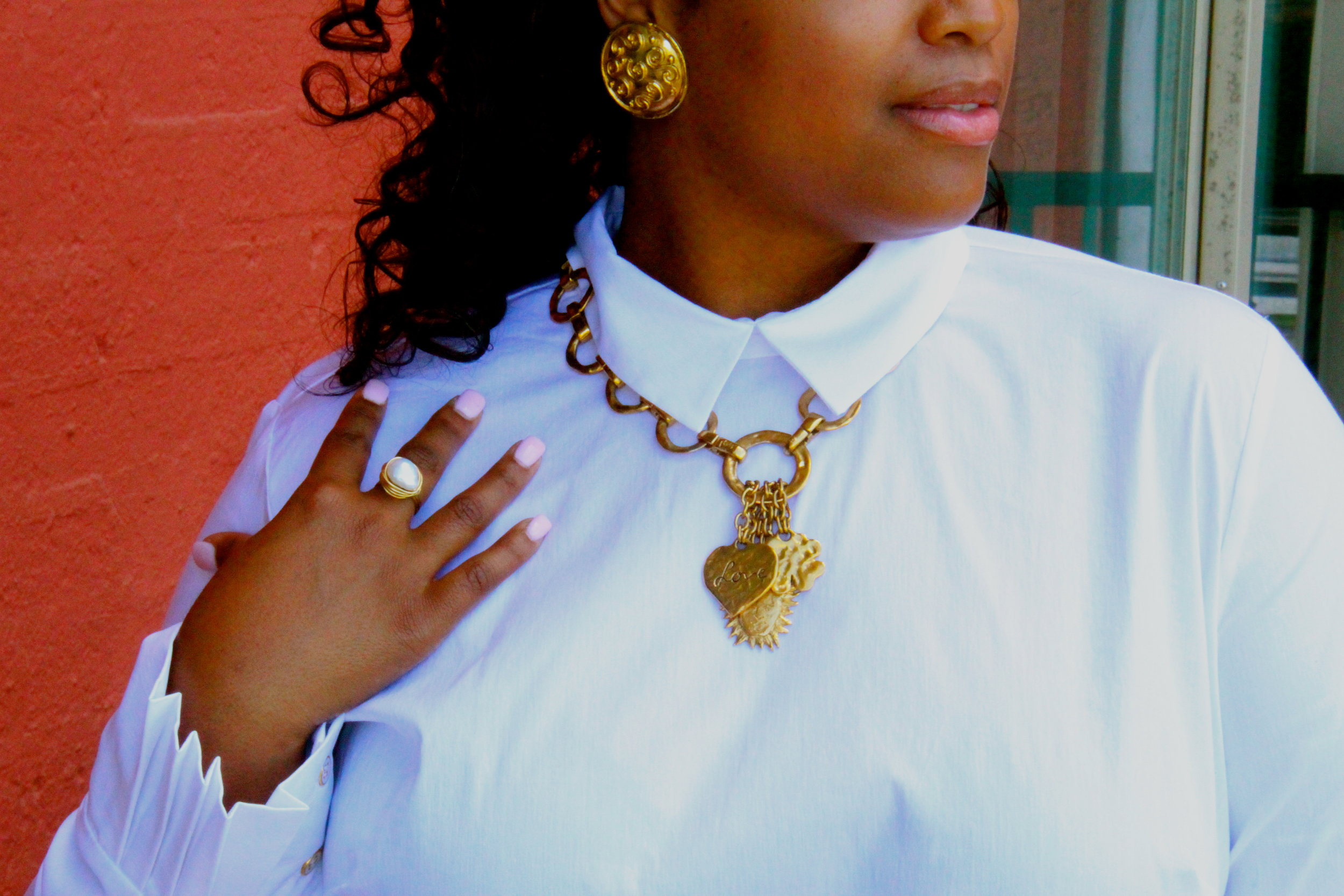 Need a classic brunch look? Pair a    crisp white shirt  with a  vintage gold necklace  and  earrings  and a hand-made oversized  freshwater pearl ring . White also goes great with an  abalone and fresh water pearl stunner paired with lovely  dominica green earrings  pictured below.