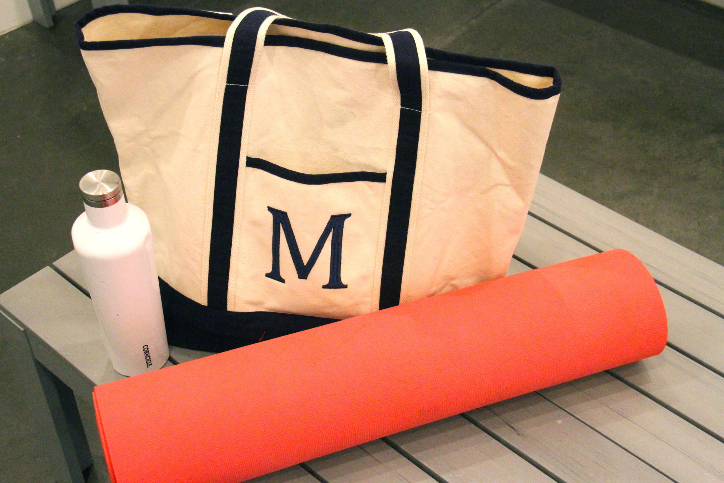 Yoga essentials:   The Mat by Lululemon  ; a cute   tote   for your belongings and a   fab water bottle  .