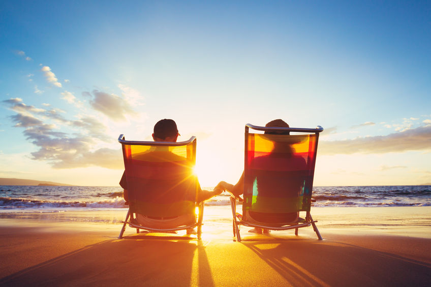 couple-sitting-in-chairs-at-beach-during-sunset.jpg
