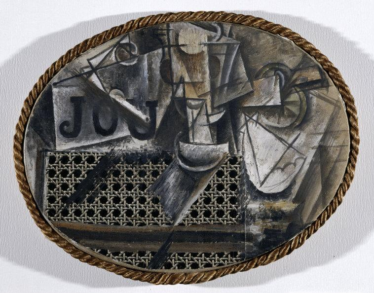 Pablo  Picasso,(1881-1973) © ARS, NY    Still-life with Chair Caning, Spring 1912. Oil on oil-cloth over canvas edged with rope, 29.0 x 37.0 cm. Photo: R.G. Ojeda.    Location:  Musee Picasso, Paris, France    Photo Credit:  © RMN-Grand Palais / Art Resource, NY    Image Reference:  ART152018