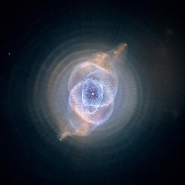The Cat's Eye Nebula, one of the first planetary nebulae discovered, also has one of the most complex forms known to this kind of nebula. Eleven rings, or shells, of gas make up the Cat's Eye.    Photo Credit:   F&A Archive / Art Resource, NY    Image Reference:   AA573528
