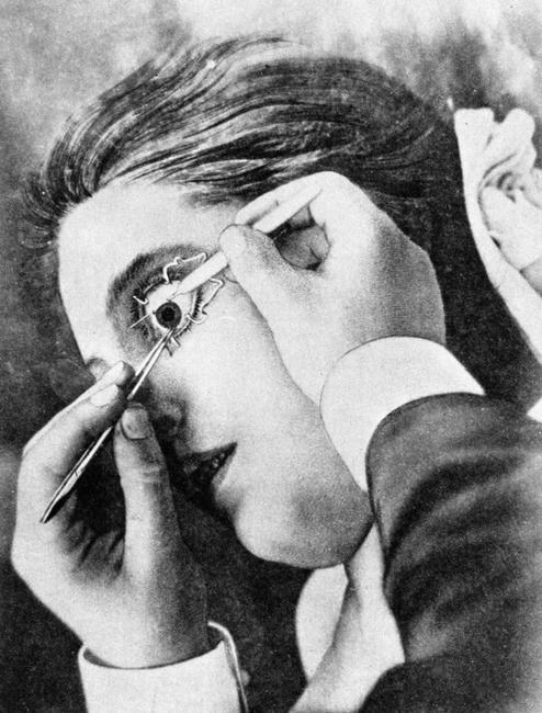 A woman having an eye operation, 1920s.    Photo Credit:   HIP / Art Resource, NY    Image Reference:   AR999513