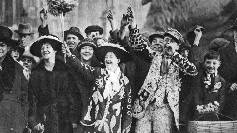 Pearly king and queen in high spirits, London, 1926-1927. Cockney 'Pearly kings' (originally costermongers - fruit and vegetable sellers), wore suits covered in mother-of-pearl buttons. Illustration from Wonderful London, volume I, edited by Arthur St John Adcock, published by Amalgamated Press (London, 1926-1927).    Photo Credit:   HIP / Art Resource, NY    Image Reference:   AR963078