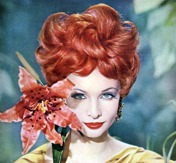 Redhead model, with a tiger lily flower and matched lipstick, c1955-1965(?). Rights information: Cleared for Editorial Use Only. Please Contact Us For Any Other Clearance Rights    Photo Credit:   HIP / Art Resource, NY    Image Reference:   AR999260