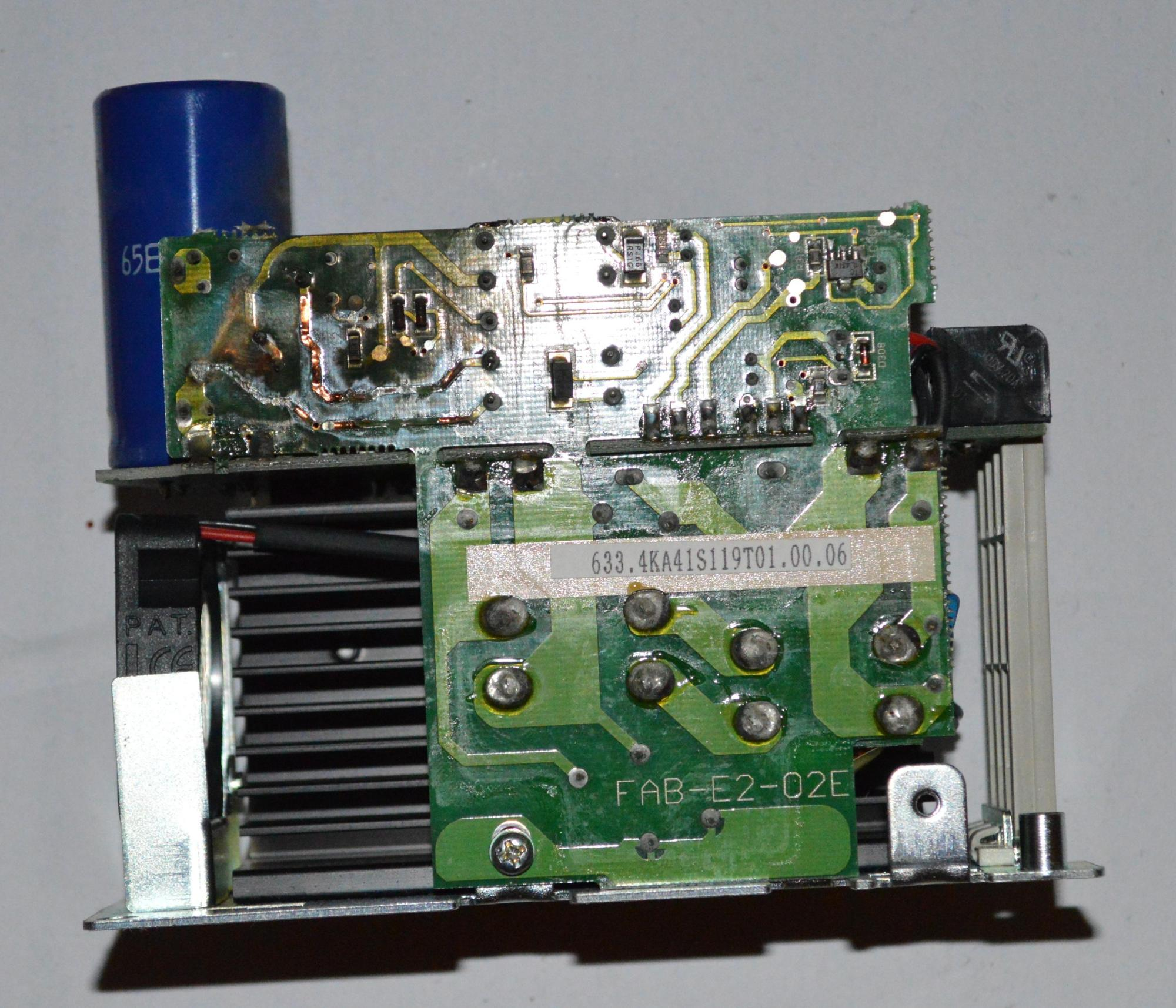 The circuit board is clearly damaged by the heat from some kind of component failure.