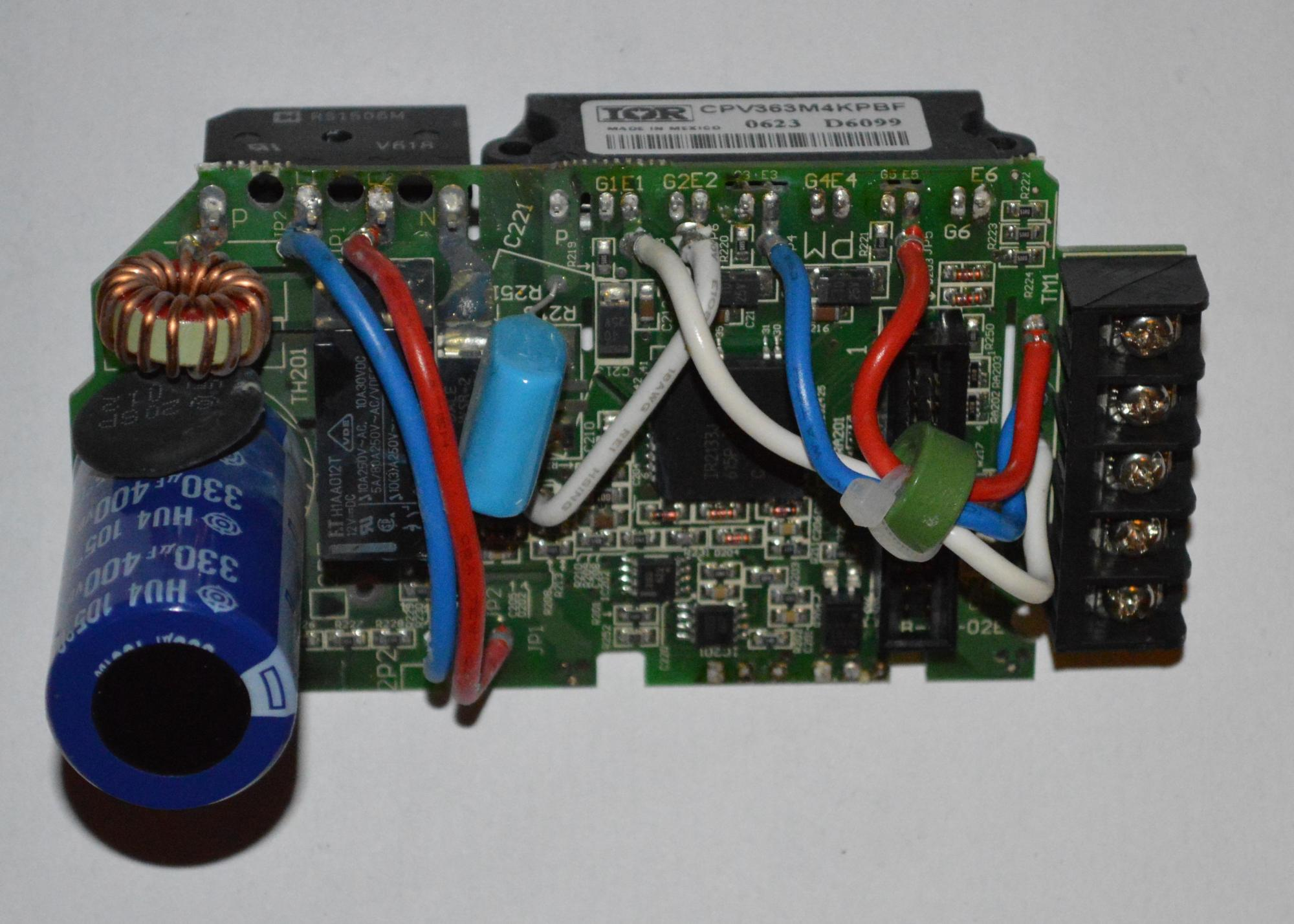Inverter power circuit board. The large capacitor to the right is the main reservoir capacitor, while the inrush limiting NTC is the black body just above the capacitor. The rectifier and inverter modules are visible at the top left and right respectively.