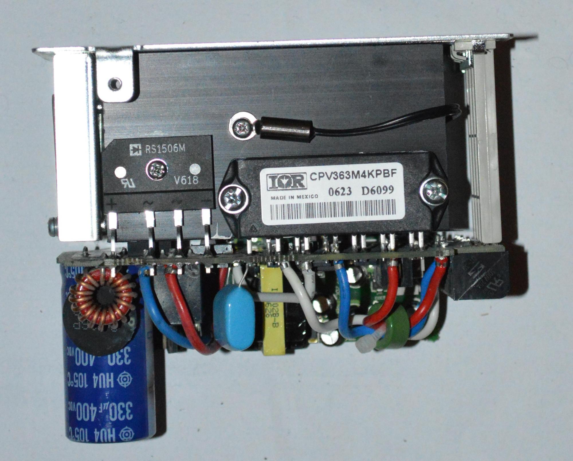 Viewed from a different angle, the attachment of the power modules to the heat-sink is visible. The wire attaced to the heat sink just above the modules is a temperature sensor.