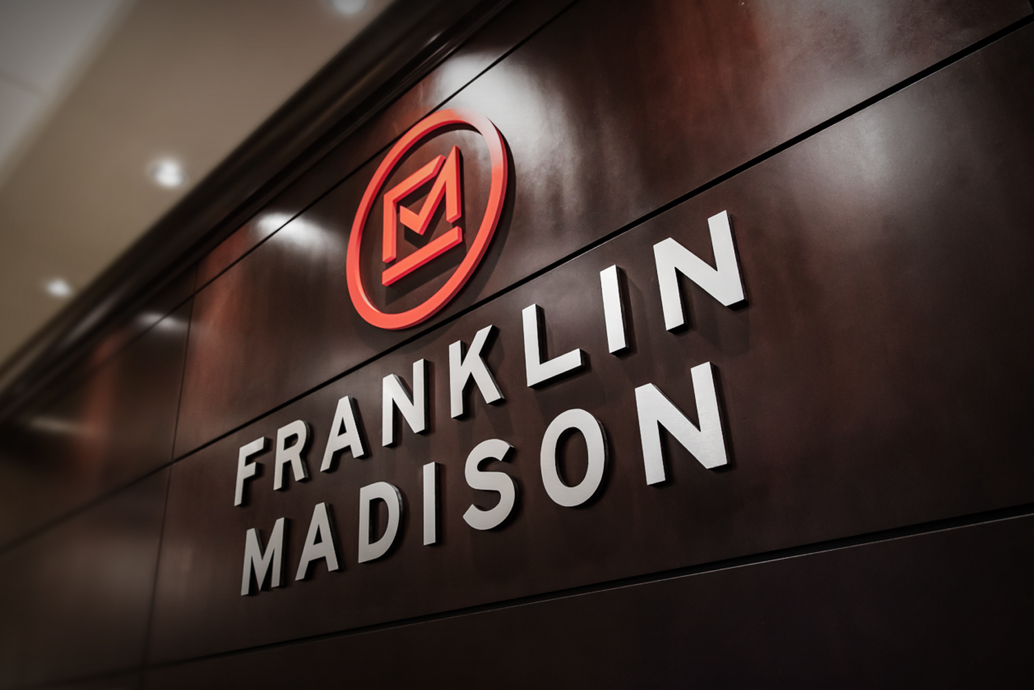 bohan | Indoor Signage for Franklin Madison. Raised letters and logos.