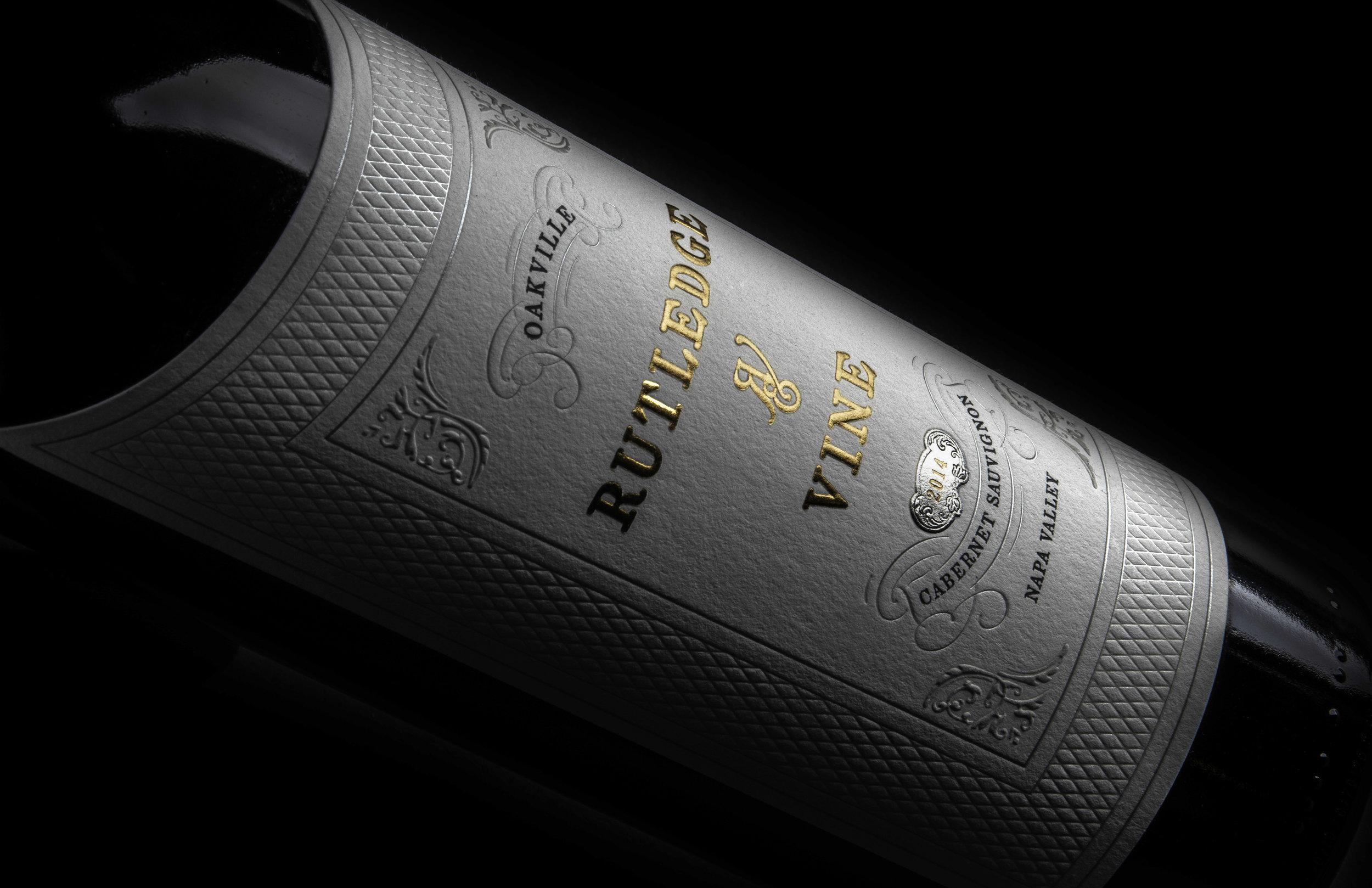 bohan | Embossed Winn bottle label with gold foil for Rutledge & Vine.