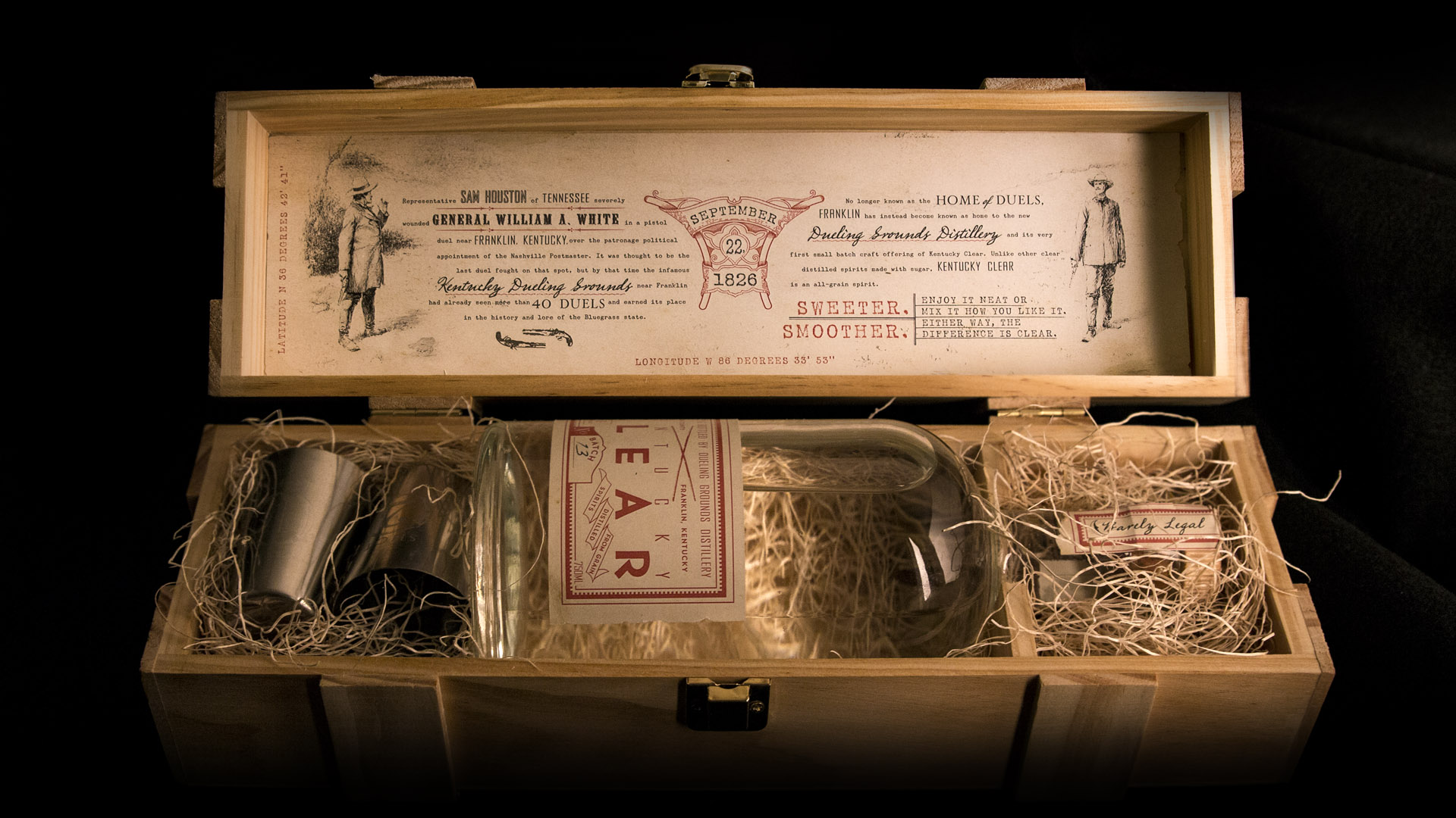 bohan | CPG | Dueling Grounds single bottle with silver shot glasses wooden crate design.