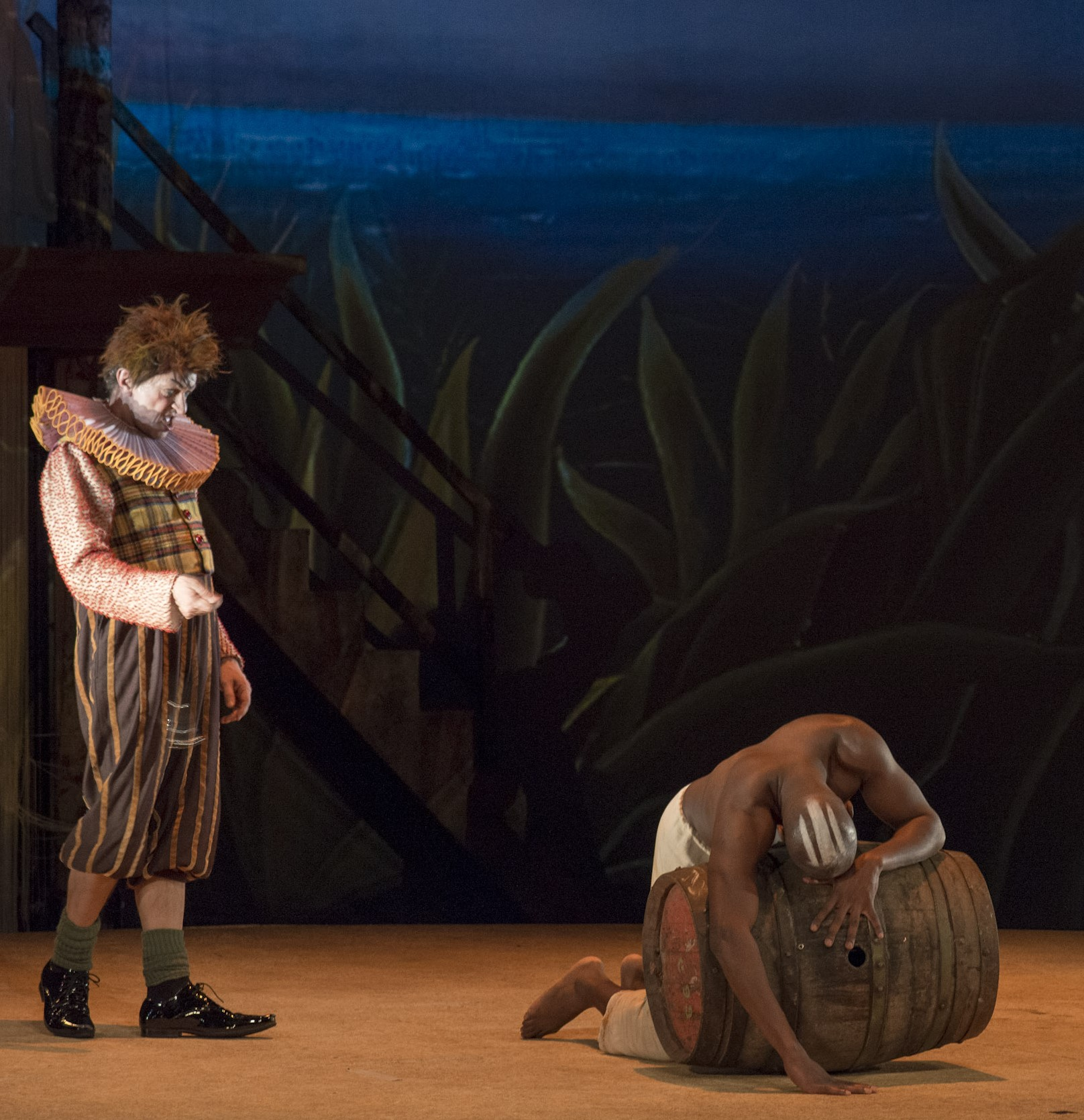 Stéphane Delbasse as  Trinculo  and Hervé Goffings as  Caliban.