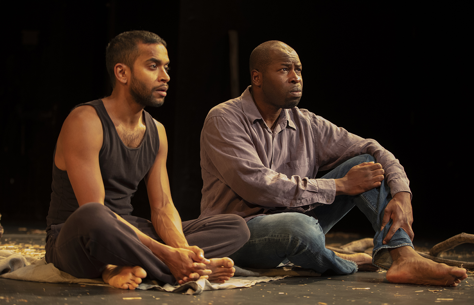DECEMBER  Hiran Abeysekera as Mavuso & Hervé Goffings as Ezekiel in Peter Brook's   The Prisoner   at  the Theatre for a New Audience  in New York. Photographer: Joan Marcus.