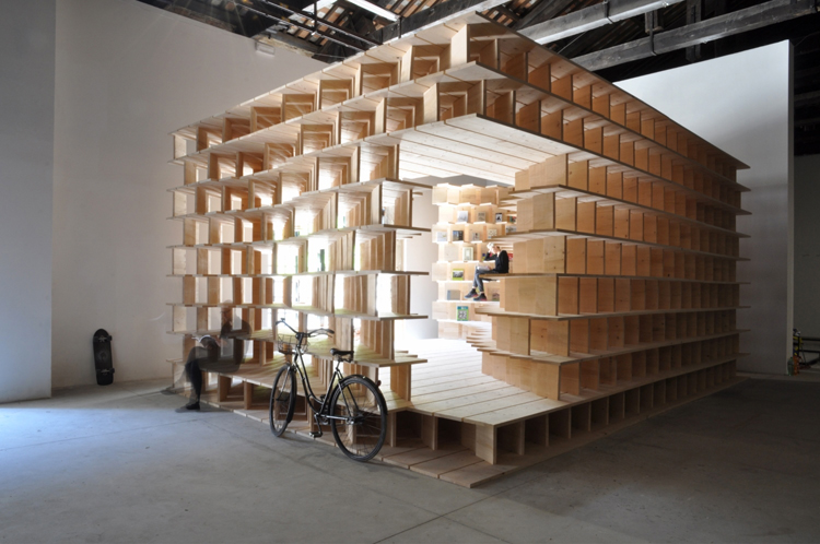 Architects Aljoša Dekleva and Tina Gregorič have built a wooden library inside the Slovenian Pavilion at the Venice Architecture Biennale that reflects on the role of the 'home' today.