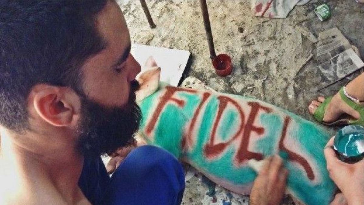 'El Sexto' spent ten months in prison for painting the names 'Fidel' and 'Raul' on two pigs / Credit: @AmnestyOnline