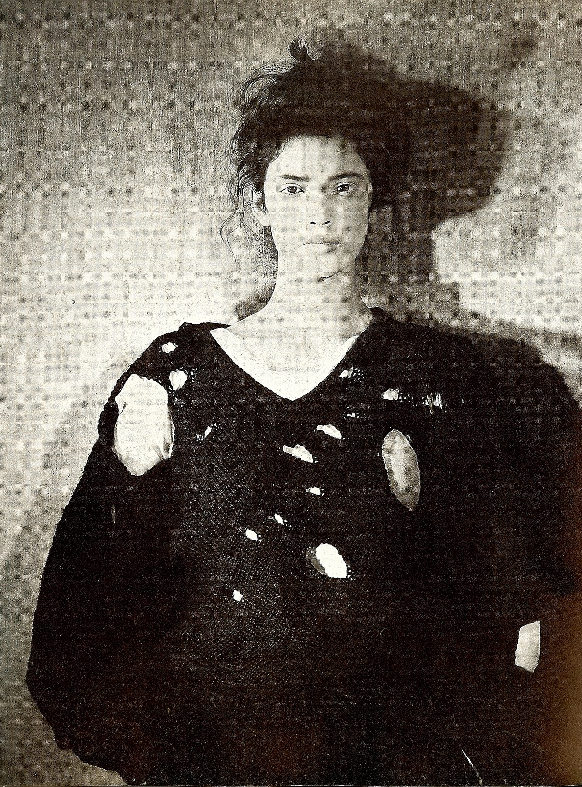 The designer's 'lace' sweater from 1982 - the seemingly random pattern of holes provides a commentary on the demise of handicraft in an era of machine-made perfection.