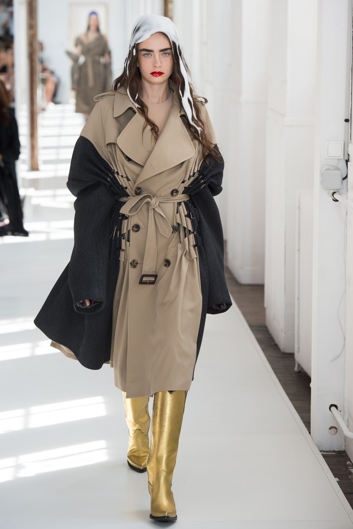 The traditional trench coat was reimagined in one of a number of contemporary styles.