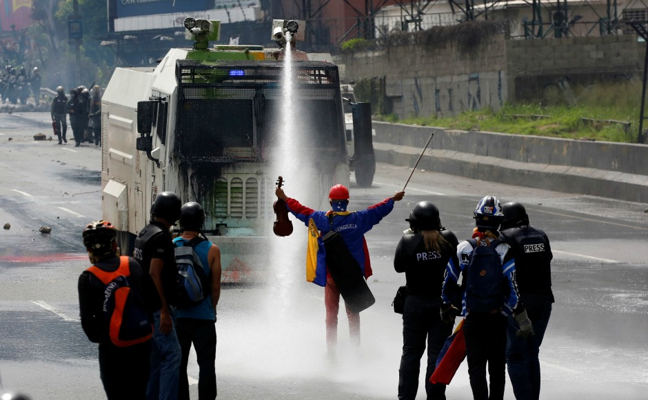 Activist and violinist Wuilly Arteaga pictured amid protests against Venezuelan President Nicolas Maduro, who was wrongfully imprisoned for his bravery.
